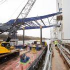 Preparations underway for bridge deck launch across river